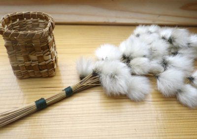 A cotton grass bouquet and a cedar bark wee basket by Kate Sankey of the West Moss-side Collective