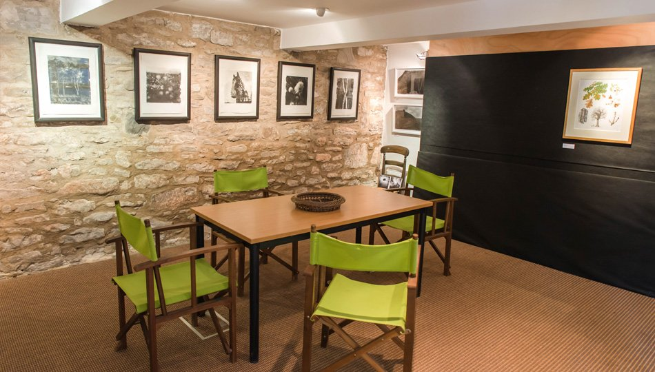 The downstairs room with artwork from Michael Prince of the West Moss-side Collective