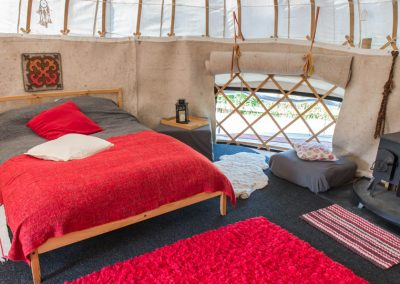 Stuc a'Chroin yurt interior: felt linings to the walls and the wood burning stove ensures warmth and comfort